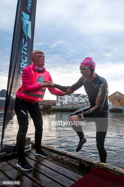 An athlete is helped out of the water at The Arctic Triple // Lofoten Triathlon Extreme distance on August 19 2017 in Svolvar Norway Lofoten...