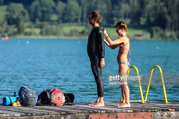 An Athlete is helped to adjust his neoprene suit ahead of the Challenge WalchseeKaiserwinkl on August 22 2015 in Walchsee Austria
