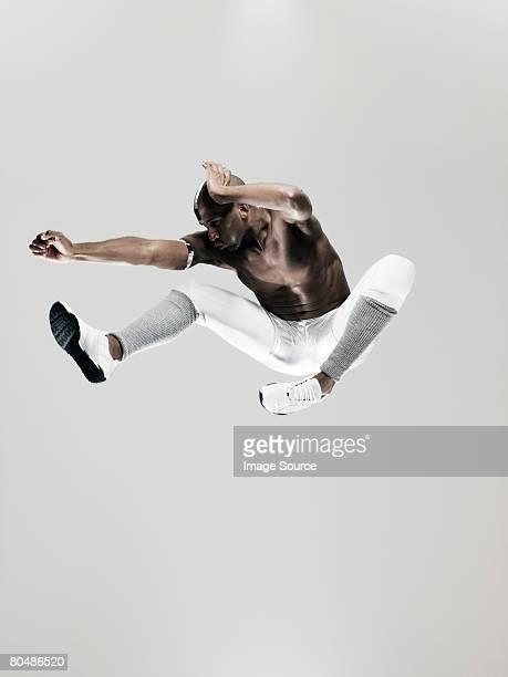 Un athlète de saut