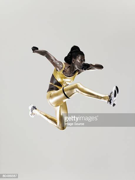 an athlete jumping - athlete stock pictures, royalty-free photos & images