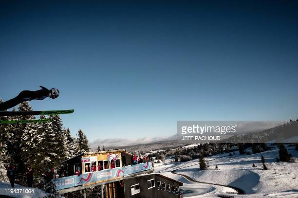 An athlete jumps as she competes in the women's Nordic Combined during the 2020 Lausanne Winter Youth Olympic Games at the Les Tuffes stadium in...