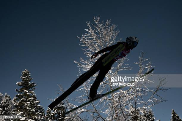 An athlete jumps as she competes in the women's Nordic Combined during the 2020 Lausanne Winter Youth Olympic Games at Les Tuffes stadium in Premanon...