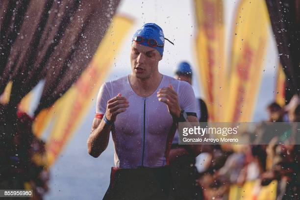 An athlete leaves the water during the swimming course of the IRONMAN Barcelona on September 30 2017 in Calella Barcelona province Spain
