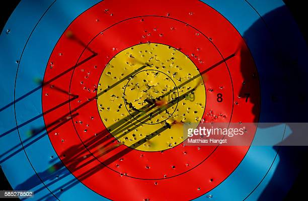 An athlete looks on his arrows in the target during a training session at the Sambodromo Olympic Archery venue on August 2 2016 in Rio de Janeiro...
