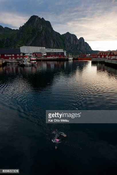 An athlete on the swimleg at The Arctic Triple // Lofoten Triathlon Extreme distance on August 19 2017 in Svolvar Norway Lofoten Triathlon is one of...
