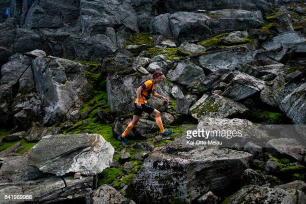An athlete on the way up the rocky trails at Hardangervidda Marathon on September 2 2017 in Eidfjord Norway Hardangervidda Marathon goes through...