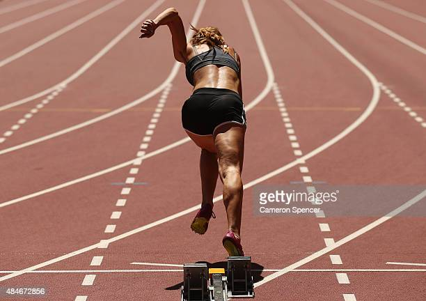 An athlete practices a sprint start ahead of the 15th IAAF World Athletics Championships Beijing 2015 at the Beijing National Stadium on August 21...