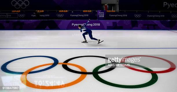TOPSHOT An athlete practices during a speed skating training session at the Gangneung Oval Arena during the 2018 Pyeongchang Winter Olympic Games in...