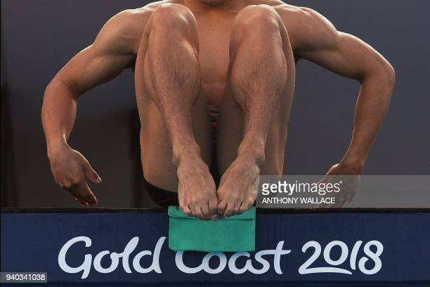 TOPSHOT An athlete prepares to dive as he takes part in a diving training session at the Optus Aquatic Centre ahead of the 2018 Gold Coast...