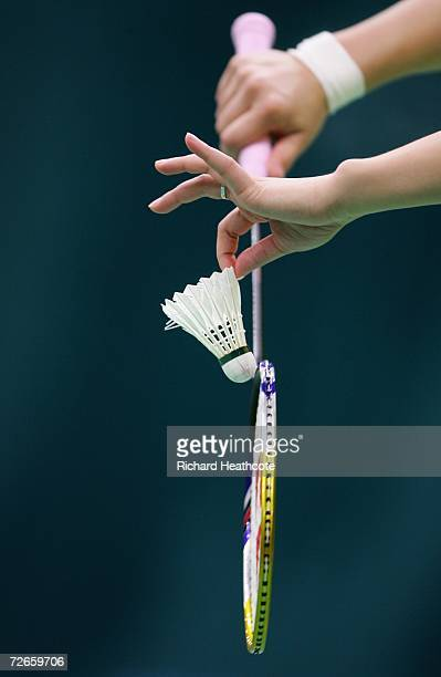 An athlete prepares to hit the shuttlecock while warming up on the Badminton courts prior to the start of the 15th Asian Games Doha 2006 at Aspire in...