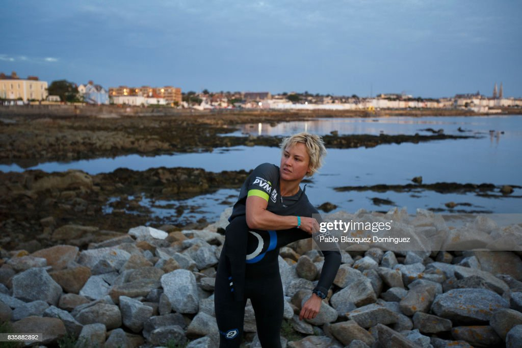 An athlete puts her wetsuit on before the start of IRONMAN 70.3 Dublin on August 20, 2017 in Dublin, Ireland.
