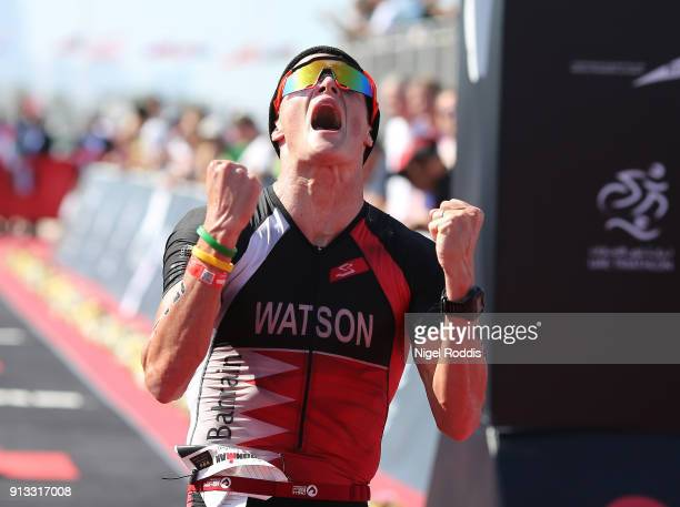 An athlete reacts after finishing Ironman 703 Dubai on February 2 2018 in Dubai United Arab Emirates