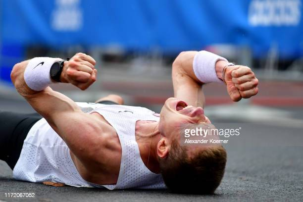 An athlete reacts after finishing the 46th Berlin Marathon 2019 on September 29 2019 in Berlin Germany