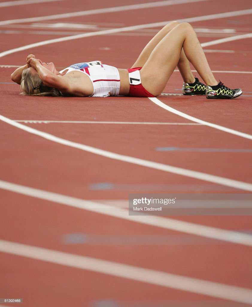 An athlete reacts after the 800 metre discipline of the women's heptathlon on August 21, 2004 during the Athens 2004 Summer Olympic Games at the Olympic Stadium in the Sports Complex in Athens, Greece.