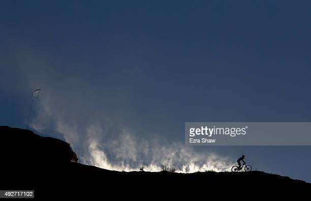 An athlete rides along the ridge line during a practice session for the Red Bull Rampage on October 15 2015 in Virgin Utah The Red Bull Rampage is an...