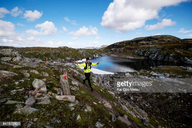 An athlete running over a mountainpass at Hardangervidda Marathon on September 2 2017 in Eidfjord Norway Hardangervidda Marathon goes through parts...