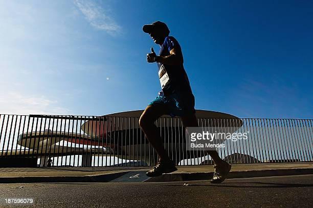 An athlete runs during the Half Marathon Faz um 21 Embratel at Orla de Niteroi on November 10 2013 in Rio de Janeiro Brazil