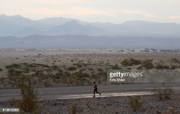 An athlete runs past the Mesquite Flat Sand Dunes during the STYR Labs Badwater 135 on July 12 2017 in Death Valley California The start of the 135...