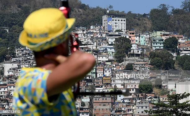 An athlete seen in front of the favela Morro da Mineira during a training session at the Sambodromo Olympic Archery venue on August 2 2016 in Rio de...