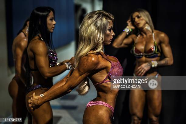 An athlete stretches as she warms up ahead of her show at the body building event part of the Arnold Classic Africa 2019 a multi-sport festival held...