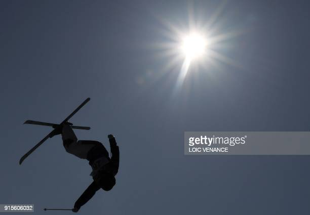 An athlete takes part in a moguls freestyle skiing training session ahead of the Pyeongchang 2018 Winter Olympic Games at the Phoenix Park in...