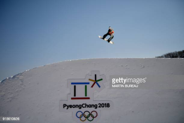 An athlete takes part in a snowboard slopestyle training session on February 8 2018 at the Phoenix Park on the eve of the opening ceremony of the...