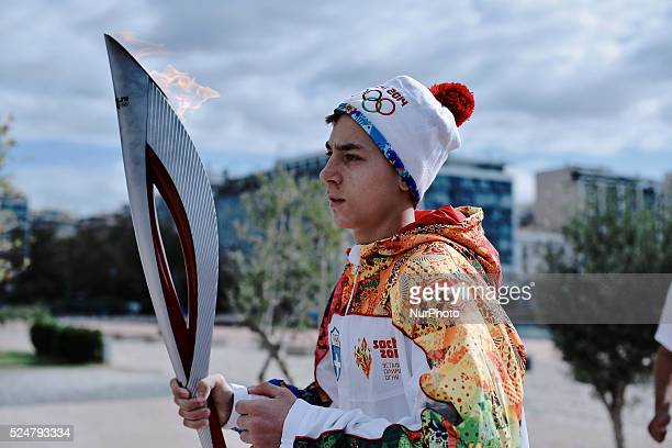 An athlete takes the Olympic Flame for the next stop The Olympic Flame of the SOCHI 2014 winter olympics arrived today morning in Thessaloniki The...