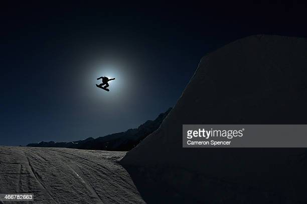 An athlete trains during Snowboard Slopestyle practice at the Extreme Park at Rosa Khutor Mountain ahead of the Sochi 2014 Winter Olympics on...