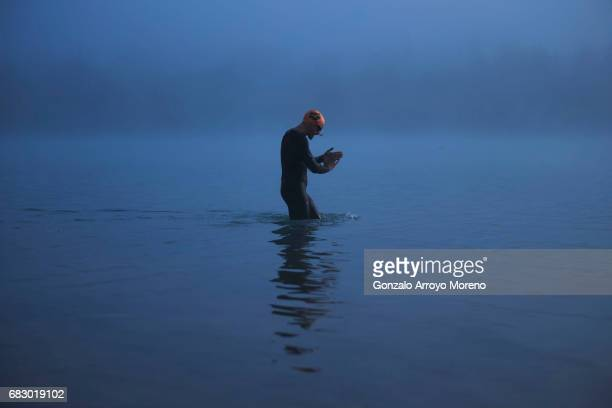 An athlete warms up prior to start the Ironman 703 Pays d'Aix swimming course on May 14 2017 at Lake Peyrolles France