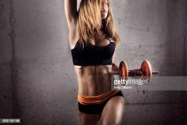 An athletic and physically fit woman in motion