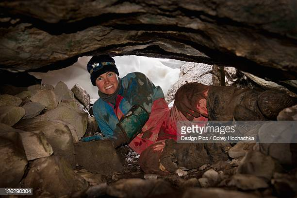 an athletic female caver - speleology stock pictures, royalty-free photos & images