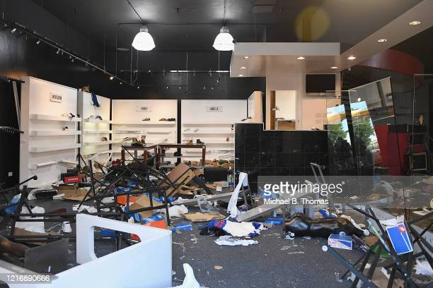 An athletic store is damaged from riots and looting overnight on June 2 2020 in St Louis Missouri Four police officers were reportedly shot in St...