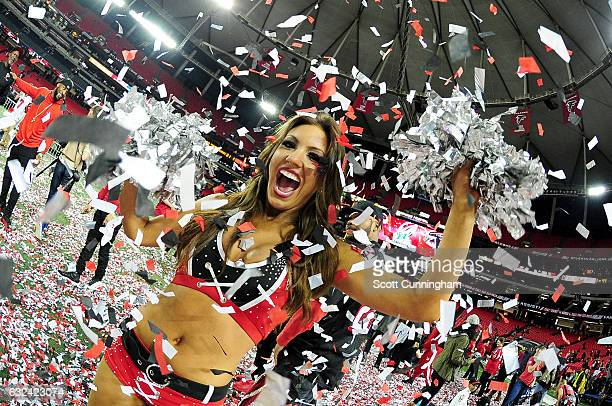 An Atlanta Falcons cheerleader celebrates after defeating the Green Bay Packers in the NFC Championship Game at the Georgia Dome on January 22 2017...