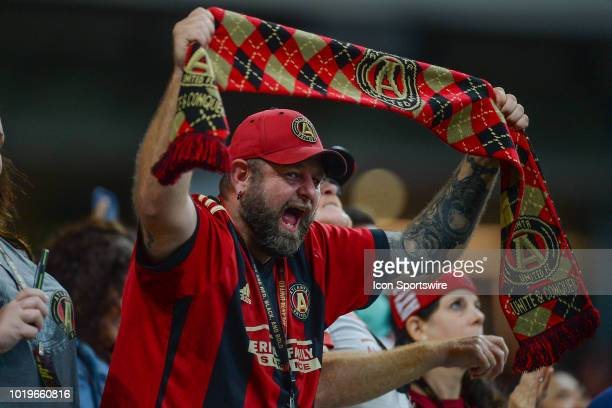 An Atlanta fan celebrates a Miguel Almiron goal during the match between Atlanta United and Columbus Crew on August 19th 2018 at MercedesBenz Stadium...