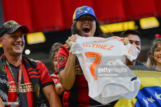 An Atlanta fan is very excited after Josef Martinez gave her his jersey following the conclusion of the match between Atlanta United and Columbus...