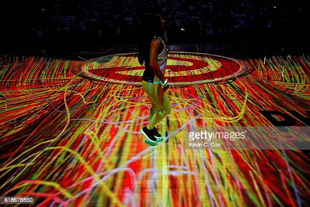 An Atlanta Hawks cheerleader performs during the pregame ceremony prior to the game against the Washington Wizards at Philips Arena on October 27...