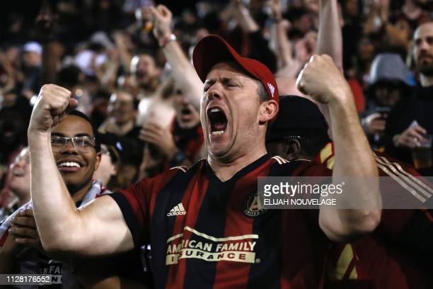 An Atlanta United fan cheers in the second half of the CONCACAF Champions League playoff football match between Atlanta United and Herediano at the...