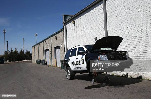 An Atlantic City police vehicle awaits repair on March 30 2016 in Atlantic City New Jersey The Atlantic City municipality is due to run out of funds...