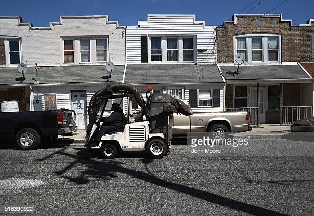 An Atlantic City public works employee sweeps the city streets on March 30 2016 in Atlantic City New Jersey The Atlantic City municipality is due to...