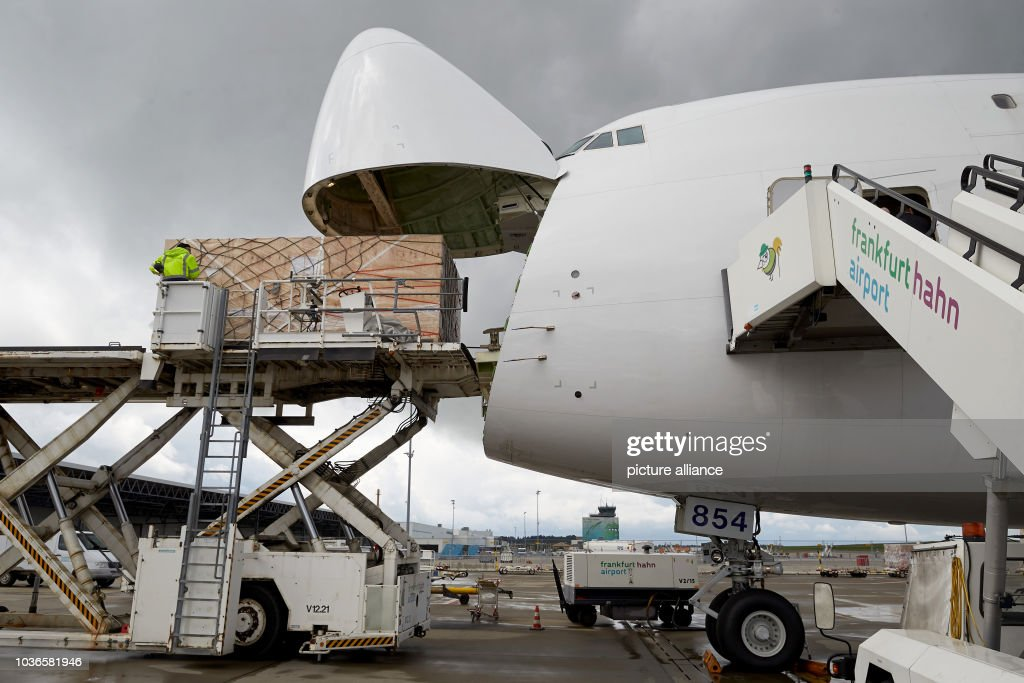 An Atlas Air Boeing 747-8 cargo plane is loaded with freight for