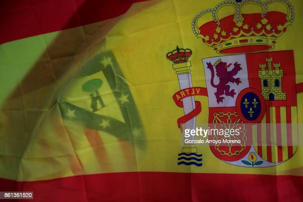 An Atletico de Madrid and a Spanish flag overlap together before the La Liga match between Club Atletico Madrid and FC Barcelona at Estadio Wanda...