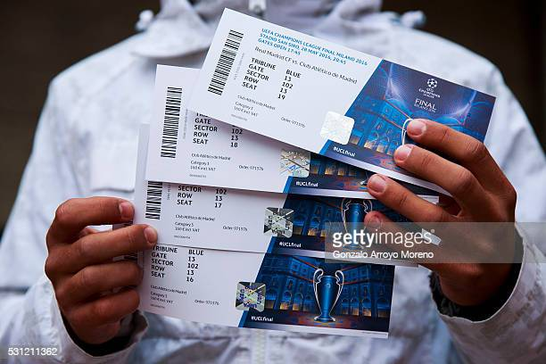 An Atletico de Madrid fan shows the camera his tickets for the UEFA Champions League Final between Club Atletico de Madrid and Real Madrid CF after...