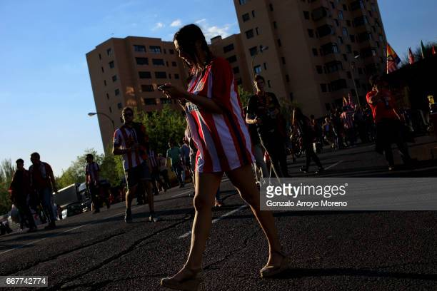 An Atletico de Madrid fan walks to Vicente Calderon Stadium before the UEFA Champions League Quarter Final first leg match between Club Atletico de...
