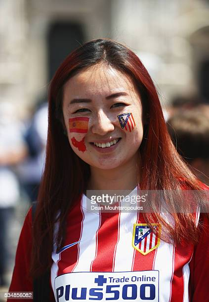 Real madrid fan stock photos and pictures getty images an atletico madrid fan enjoys the atmopshere at piazza duomo ahead of the uefa champions league voltagebd Image collections