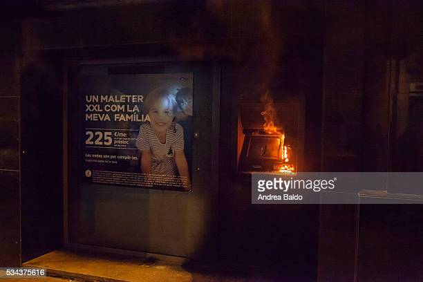 GRACIA BARCELONA CATALUNA SPAIN An ATM is set on fire while riot police officers clash with protestors in Barcelona's Gracia neighbourhood two days...