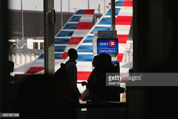 An ATM machine sits in front of American Airlines aircraft at O'Hare International Airport on June 17 2014 in Chicago Illinois US consumer prices...