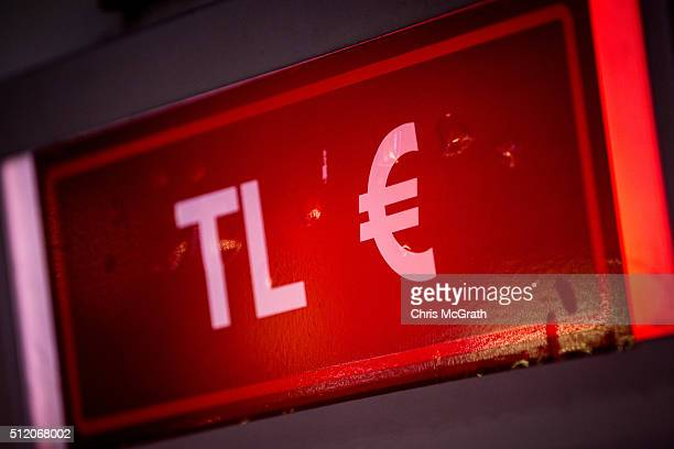 An ATM sign offering both Turkish Lira and Euros is seen at a bank on February 24, 2016 in Istanbul, Turkey. Recent terrorist attacks, national...