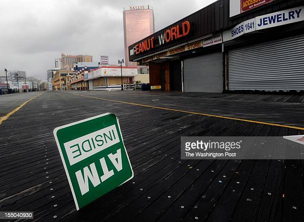 An ATM sign that blew off and is stuck on the boardwalk in Atlantic City NJ a day after Hurricane Sandy make landfall