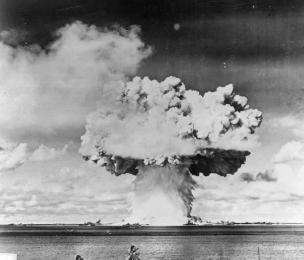 An atomic bomb test explosion off Bikini Atoll, Micronesia....