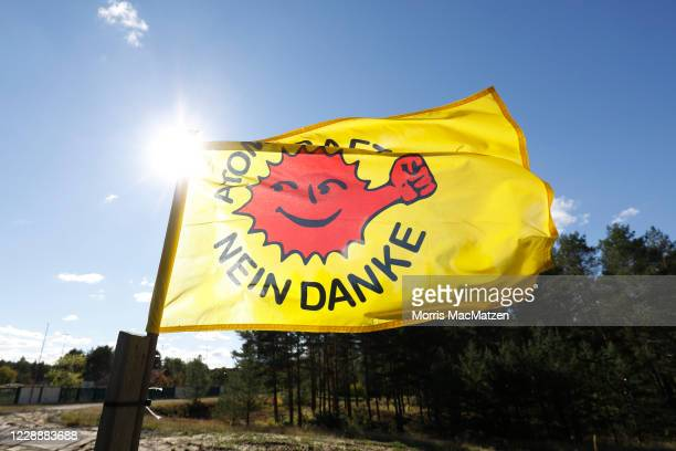 """An """"Atomkraft - nein danke"""" flag is seen as protesters march to demand that science takes priority in the search for a new site for storing Germany's..."""